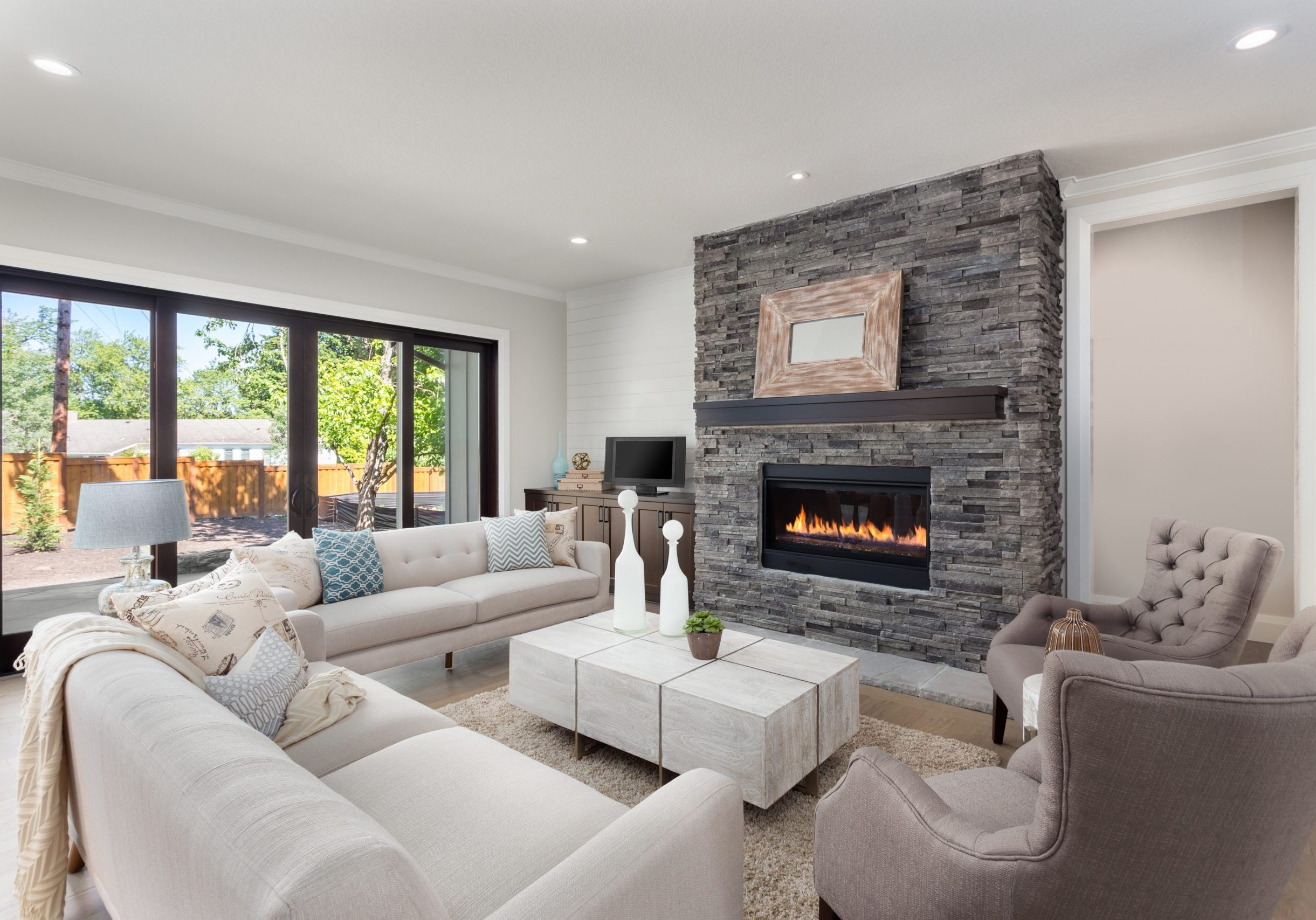 Beautiful Living Room Interior in New Home with Fireplace and Hardwood Floors