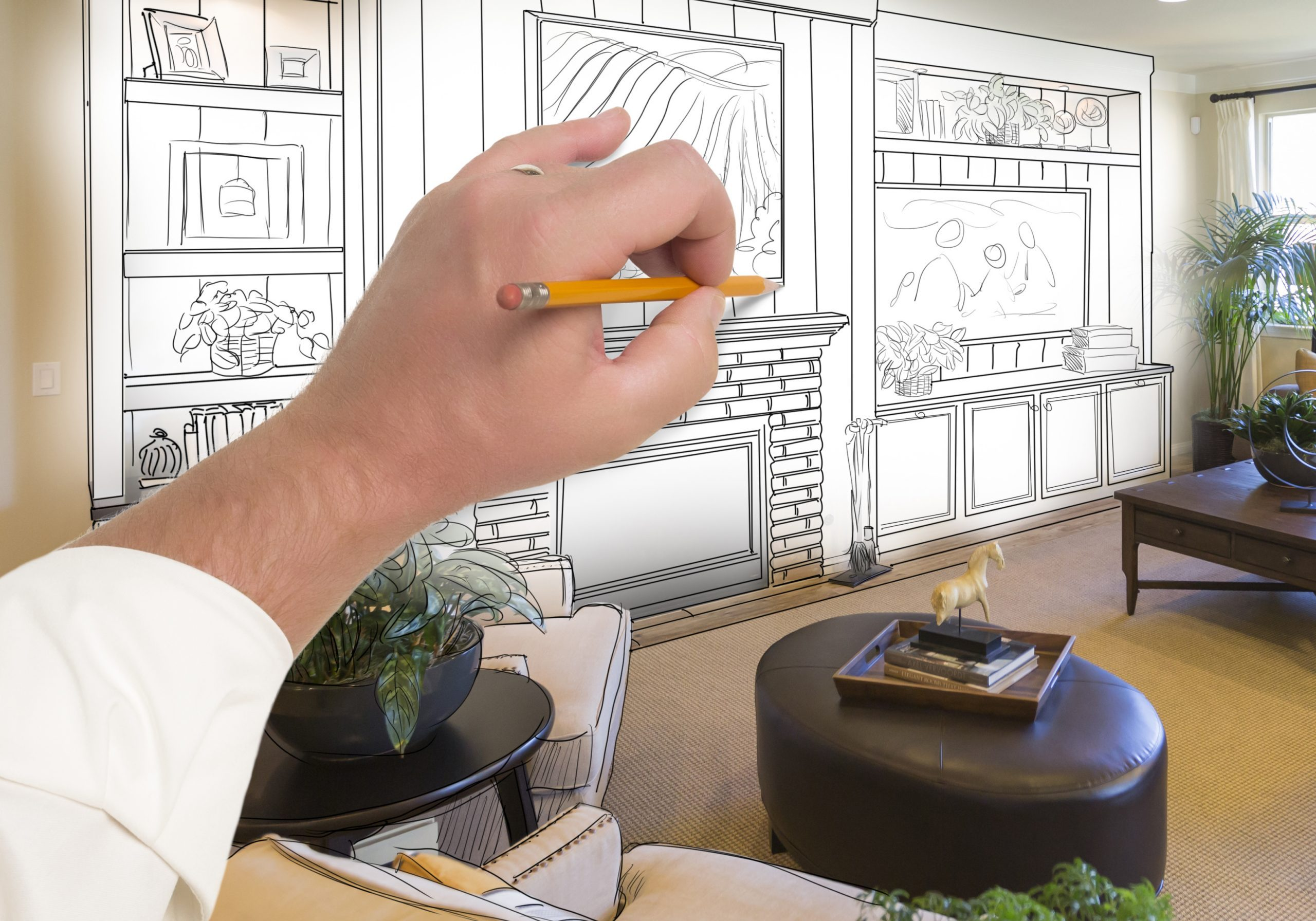 Male Hand Drawing Entertainment Center Unit Over Photo of Beautiful Home Interior.